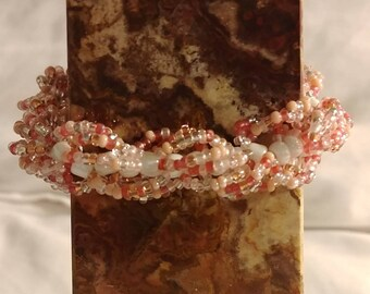 Six strands of Pinks and peach colored glass beaded Bracelet