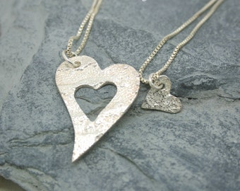 Mummy and Me. Two fine silver patterened heart pendants