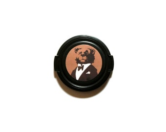 Bowtie bear camera lens cap for Canon, Nikon, Fuji, Sony etc. DSLR, mirrorless and point and shoot cameras. Free shipping in North America.