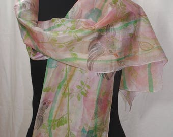 Handprinted and Handprinted silk scarf with floral design.