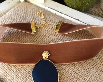 "1"" copper suede choker with a 1 1/2"" drop blue stone pendant with gold and pearl accent"