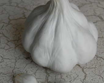 large porcelain garlic head, cloves, faux food, photo styling