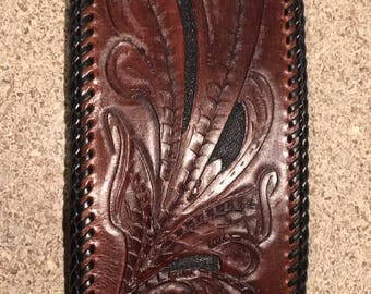 Hand carved and laced leather wallet