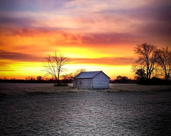 Inspiration Sunrise over a frozen farm field with barn print for home, study or office
