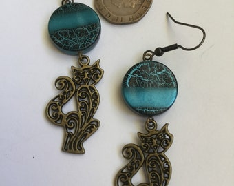 Bronze cat earrings with blue/black beads