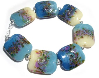 SRA Handmade Glass Lampwork Beads, Blue Florals Squeezed