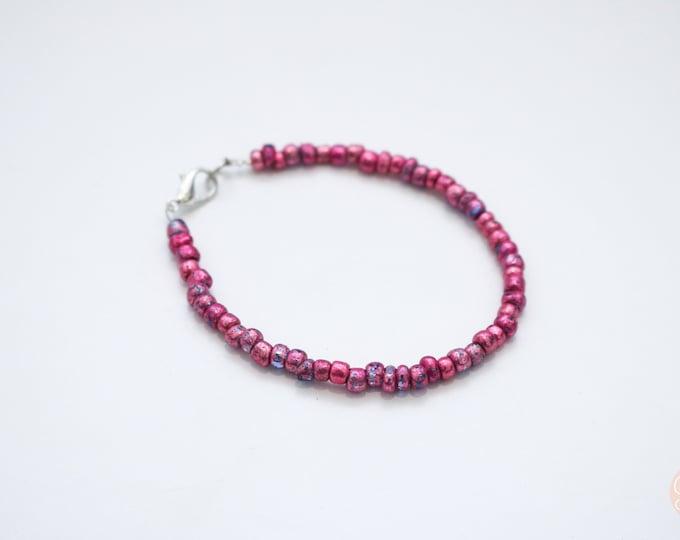 Pink seed bead bracelet.