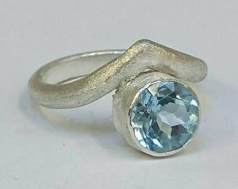 Sterling silver handmade chevron style band with 8m round blue topaz gemstone. Hallmarked in Edinburgh