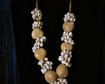 Wooden beads with mini sea shells.