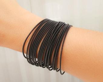 Thin black bracelet - Strech bracelet - Spring bracelet - Layered bracelet - Guitar String Bracelet Stack - Flexible bracelet