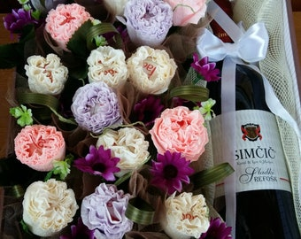 Handmade boxes with crep flowers with candies in each flower and a bottle from your favourite wine