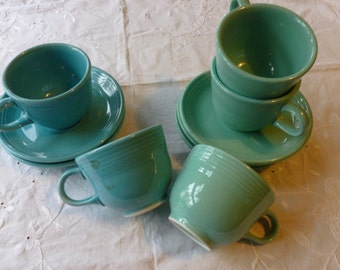 Blue and Green Fiesta Ware cups and saucers