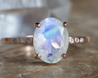 Oval-Cut Moonstone Engagement Ring with Pave Diamond Band