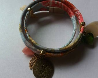 Asian inspired wrap bracelet with charms.