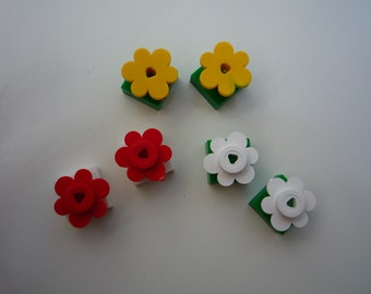 Flower earrings made from Lego® pieces on a green oner in yellow, pink, red, white, pink or blue. Hypoallergenic surgical steel studs.