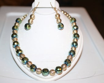 Handcrafted beaded necklace and earrings. By BS