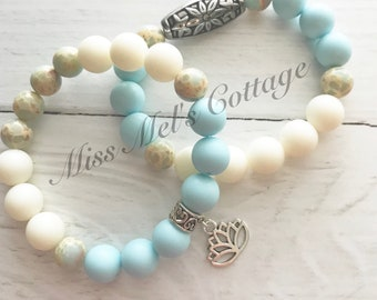 Soft Pastel Blue and Cream Beadss Stretch Bracelet with Lotus Flower Charm/Stacking Bracelets/Mother's Day