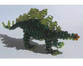 Miniature Stegosaurus in seed beads and copper wire