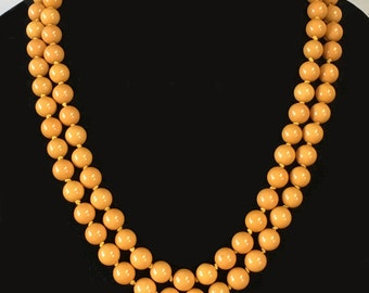 Very long beaded necklace, Deco early plastic beads, butterscotch color, nice weight and quality, not bakelite, lacquered plastic?