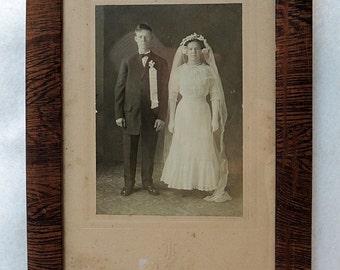 Antique photo of Bride & Groom In Original Wood Frame.. Estate Find