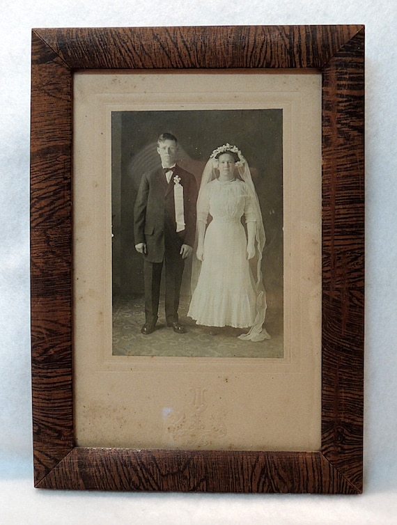 Antique photo of Bride & Groom In Original Wood Frame.. Estate Find