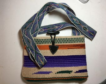 Cross body handbag handwoven with wool with fabric lining and handwoven strap