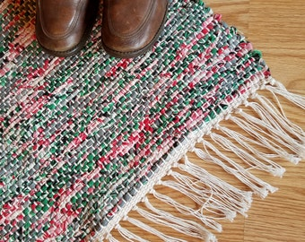"""Shades of Grey, Green and Pink filter through this vintage woven Barkcloth rug.   24"""" x 35"""" plus fringe."""