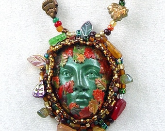 Celtic Nature Spirit Green Woman Goddess Face Bead Embroidered Necklace Made from Polymer Clay and Surrounded with Glass Leaf Beads