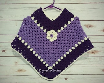 Poncho in child size. Purple, lavender and cream colors. Handmade to order.