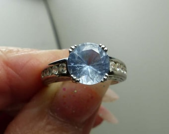 Sterling Silver Blue Topaz Ring Sz 6- beautiful cut CZ's on sides-3.3 grms -no etching- 1843