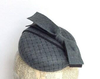 Gray felt  fascinator with black veiling detail