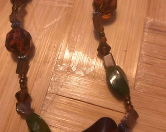 Beautiful vintage hand beaded necklace. Earth tones glass beads.