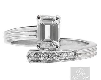 Emerald cut and round cut diamonds 9ct white gold ring