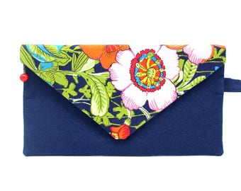 A clutch made of navy blue cotton patterned with exotic flowers