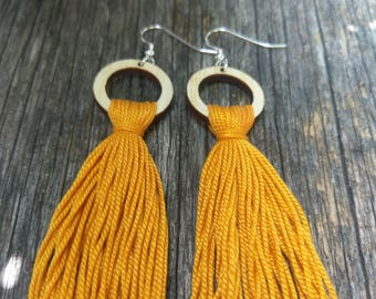 Full Moon Jellyfish. Bamboo Plywood. Organic Cotton Tassel. Sterling Silver Fish Hooks. Statement Earrings