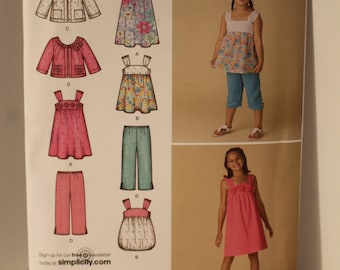 Simplicity 2469 Girls top, pants, jacket and dresses sizes 7-14