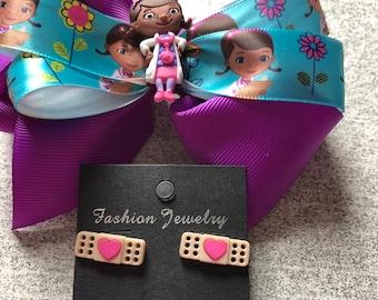 Disney Doc Mcstuffins hair bow and earring set.