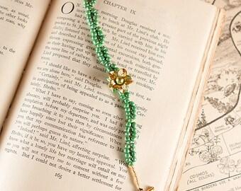 Gold Flower Button on Chain of Green Bracelet