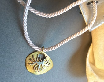 Ala Matisse pendant in Brass and German Silver on white silk upholstery  rope