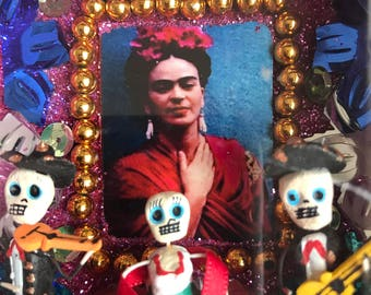 Day of the dead box with clay skull figures and Frida Kahlo 3x3x2 inches in size