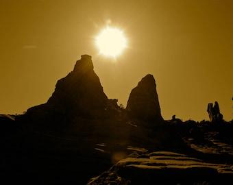 Desert Sun behind the rocks in AZ