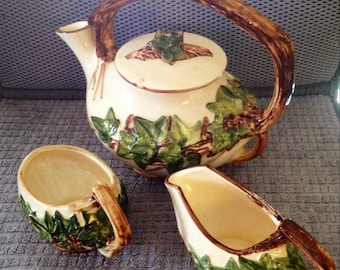 Vintage McCoy Teapot, Creamer, and Sugar with Ivy Decoration.