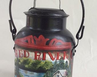 Red River Creamery on black milk pail