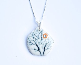 Hand made and hand painted porcelain and silver necklace.