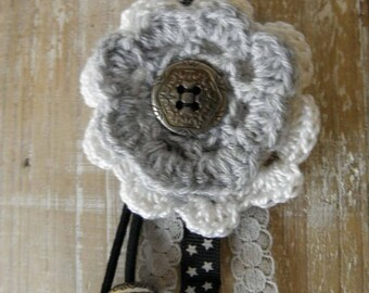 Bag charm with crocheted flowers, Ribbon, stars and lace