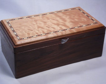 Walnut and quilted maple tea chest.