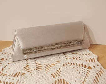 La Regale Silver Satin Beaded Clutch with  Convertable Handle  with Snap Closure presented by Donellensvintage