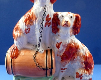 Antique Staffordshire Dogs Figurine. Pair of King Charles Spaniels Sitting on top of a Barrel
