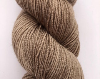 A super soft, 4 ply hand dyed yarn in a merino, cashmere, nylon blend in a tonal light brown.