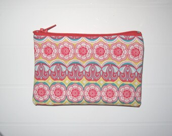 Small red and yellow purse with flowers